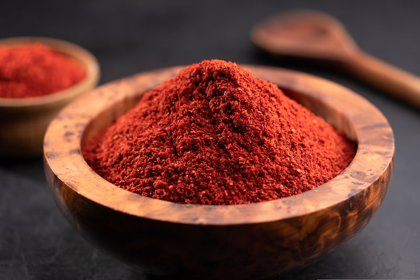 Red chili powder or paprika in a wooden