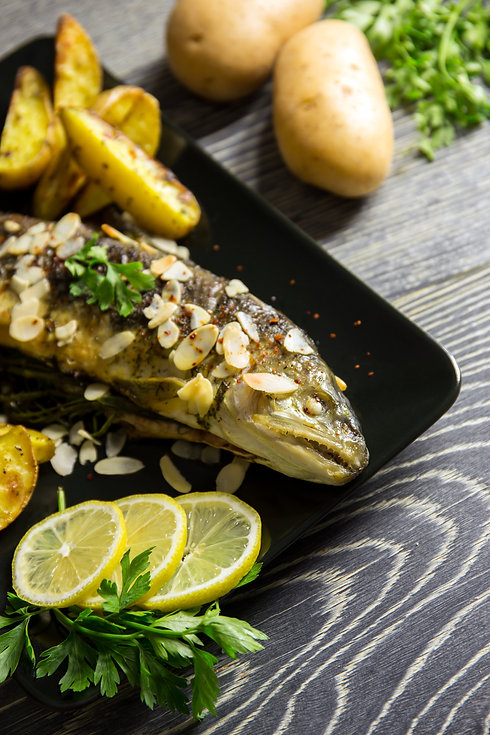 Fried trout with almonds, dill and potat
