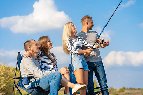Group of young friends fishing on the pi