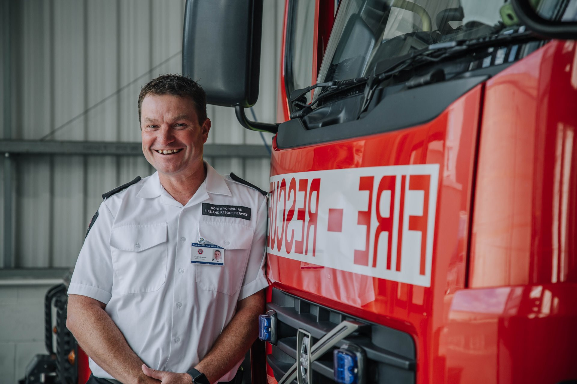 Stu Coaching Picture with Fire Engine.jp