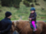 a-young-girl-on-a-horseback-riding-an-ic