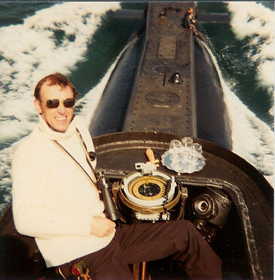 Andy Benford, the designer of THEY COME UNSEEN, on the bridge of HMS OTUS