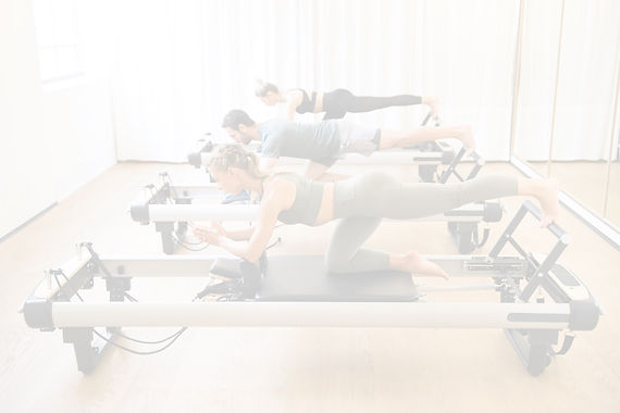 Friends-doing-pilates-kneeling-glutes-ex