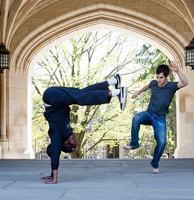 2 students playing a game in an arch