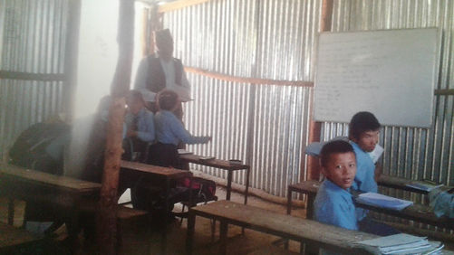 Children in temporary classroom followin