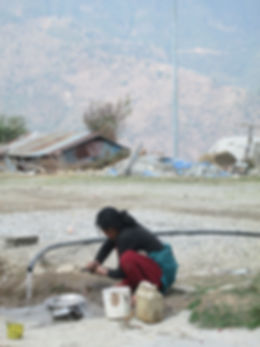 Village woman doing dishes at the Villag