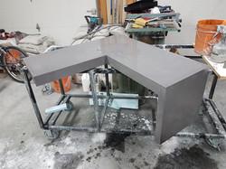 Corner changing bench