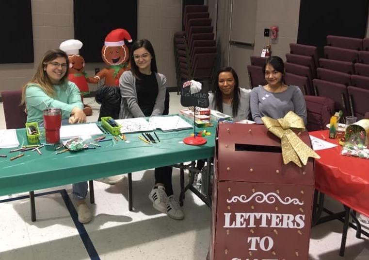 Volunteers helping send letters to Santa!