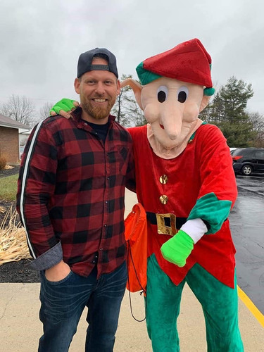 Pastor Jeremy with one of Santa's elves.
