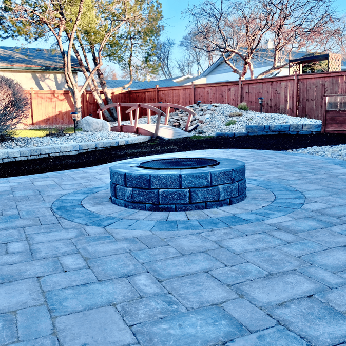 Full backyard landscape installation, Barkman Concrete stackstone firepit, roman pavers, custom inlay - Winnipeg, Manitoba