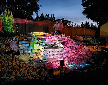 Beautiful pondless waterfall with solar lights in Winnipeg, Manitoba