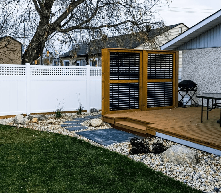 Modern privacy fence installation, charcoal brookeside slab installation with landing patio - Winnipeg, Manitoba