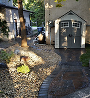 Barkman Concrete's Grand Flagstone Patio paired with 4 x 8 charcoal border hour glass shaped patio
