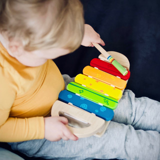 toddler playing wooden xylophone.jpg