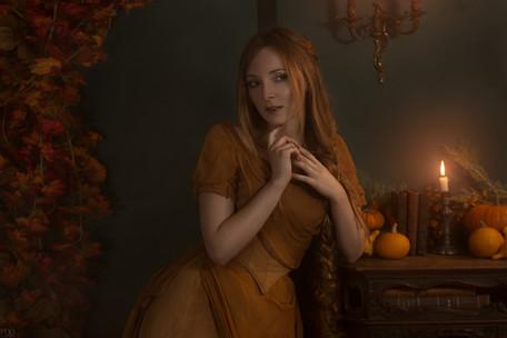 Studio photo aménagé avec citrouilles et bougies