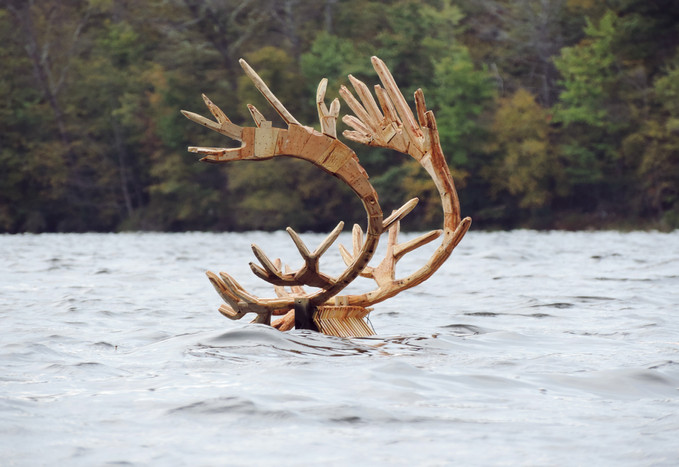 And in the distance the passing of a great black caribou, 2019, wood