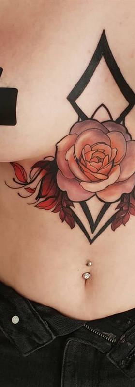 rose sternum tattoo idea feminine