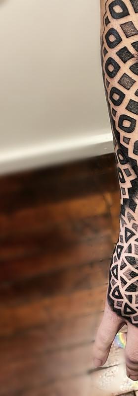 Geometric sleeve pattern tattoo hand tattoo blackwork