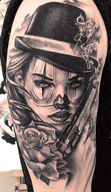 Gangster chicano girl tattoo