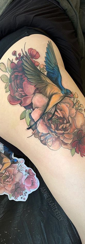 Floral Swallow tattoo neotraditional