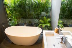 Designer freestanding bath tub