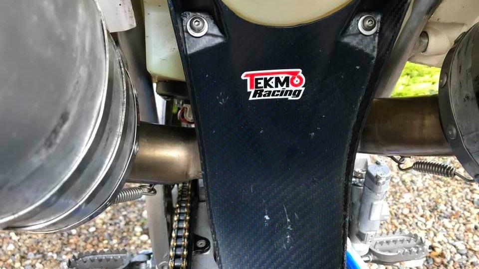 TM Racing Carbon Rear Shock Guard by Tekmo Racing.