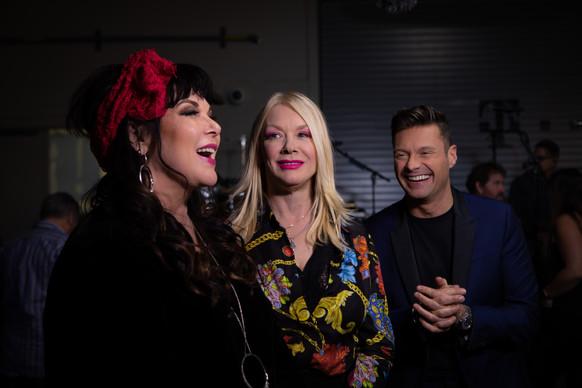 Ann Wilson, Nancy Wilson, Ryan Seacrest backstage at iHeart Music Festival. (Las Vegas)