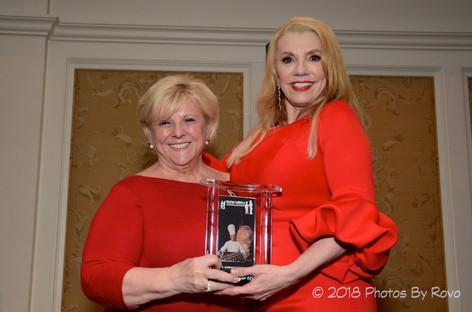 Marie Taylor Bosarge receiving the Ambassador Award