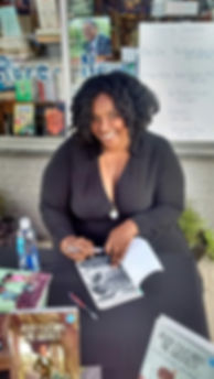 Marti Dumas signing a cop of Jaden Toussaint, the Greatest Episode 5 outside of Blue Cypress Books in New Orleans