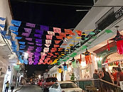 colorful banners on the cobblestone streets of downtown Puerto Vallarta