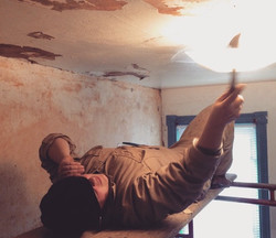 Scraping wallpaper off the ceiling
