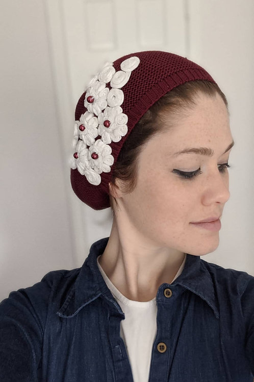 Burgundy beret with white flowers