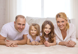 happy-family-on-clean-carpet-team-clean-colorado