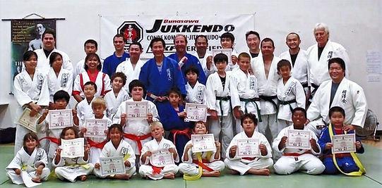 Bunasawakai judo promotion day with judo belt and certificates