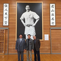 Nori Bunasawa in front of the Maeda Memorial w/ Masayoshi Fukada, executive director of Amori Judo Federation
