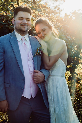 Vinyards couple pose