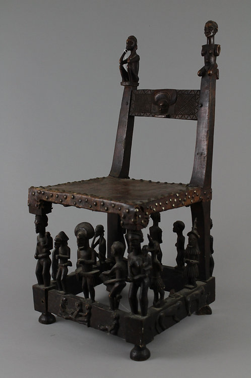 Wood Carved Chair with Animal Hide Seat