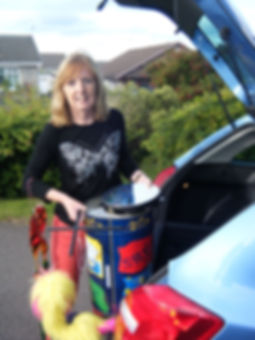 Diana loading her car with percussion instruments and props