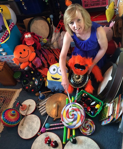 Diana with a selection of percussion instruments and props
