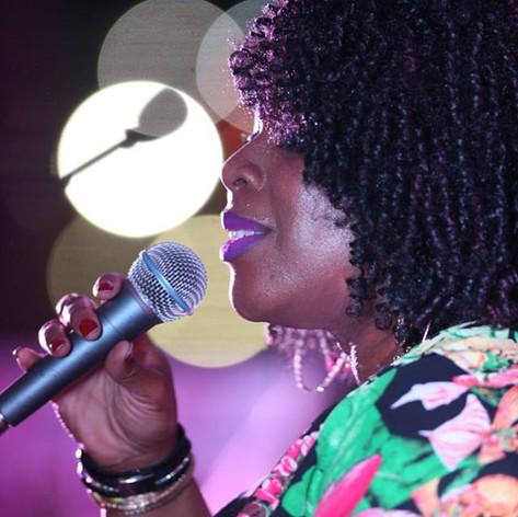Monique Ella Rose singing at 2017 Review Awards.jpg