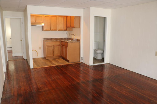 An open layout with a secluded kitchen, perfect for entertaining small groups.