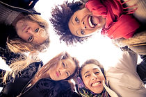 Group of attractive young women of diffe