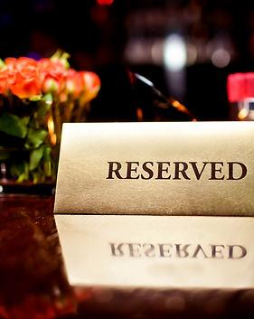 Reserved sign in restaurant.jpg