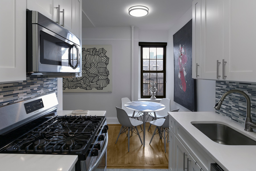Real Estate Photo of kitchen and dining area in The Bronx, New York City.