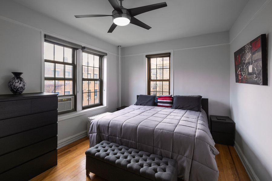 Real Estate Photo of a master bedroom in an apartment in The Bronx, New York City.