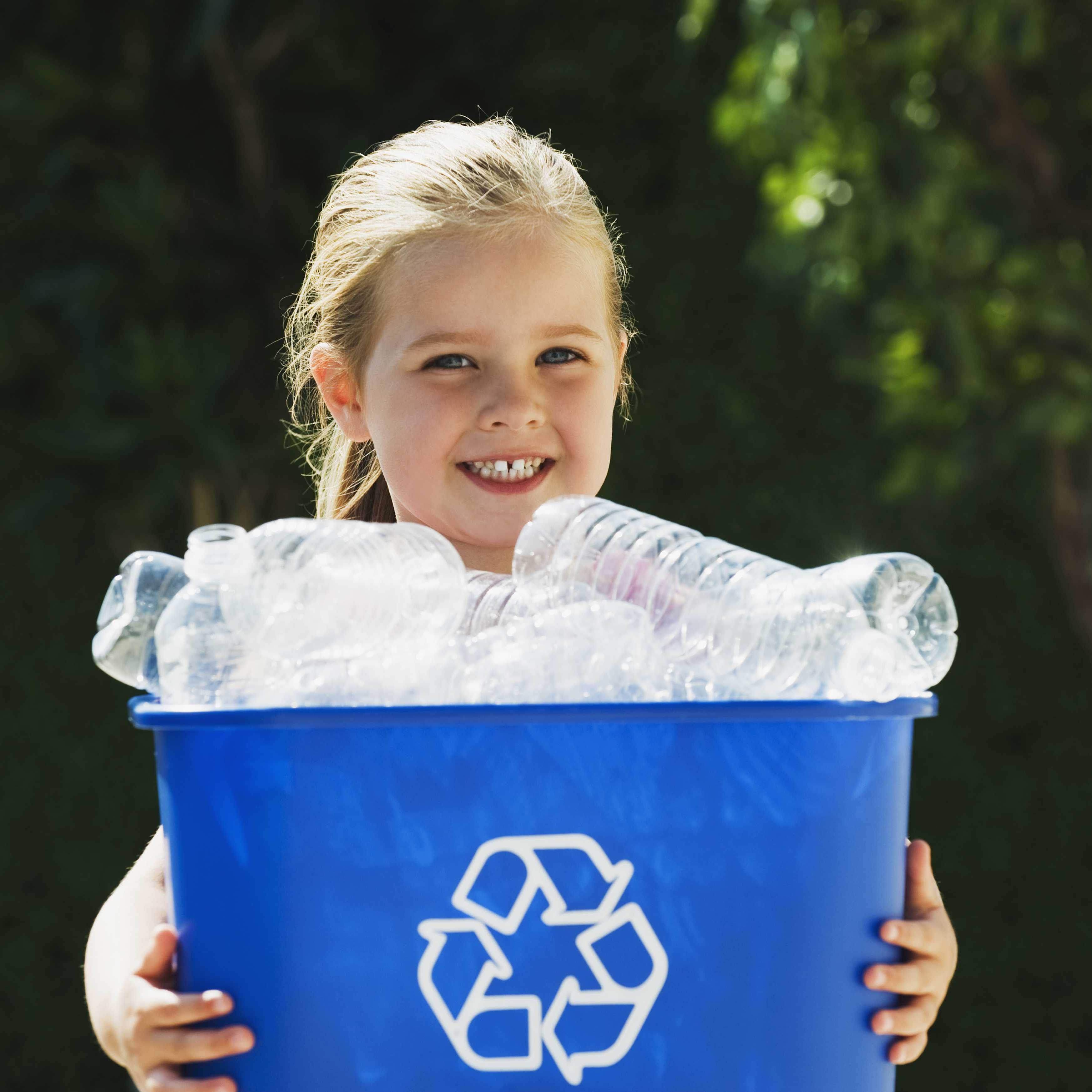 Little Girl Holding Recycling Bin.jpg