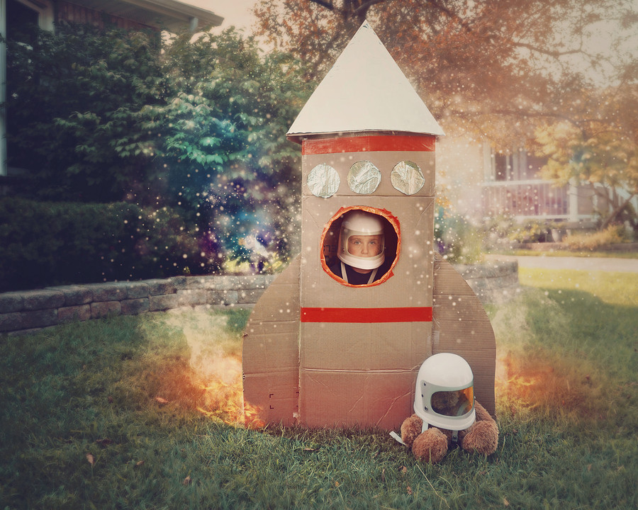 bigstock-Little-Boy-In-Cardboard-Rocket-70644202.jpg