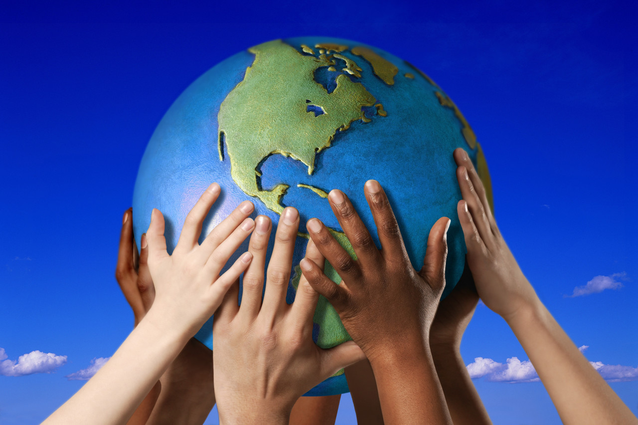 diverse-hands-with-globe.jpg
