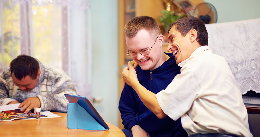 happy friends with disability socializing through internet.jpg