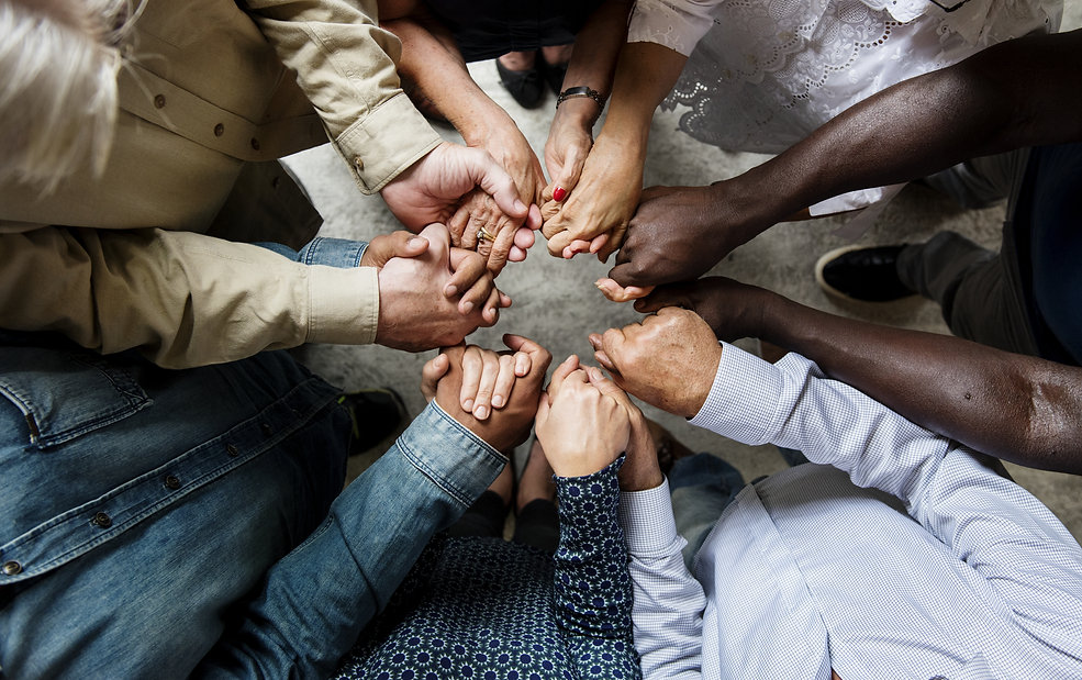 Group of diverse hands holding each other support together teamwork aerial view.jpg